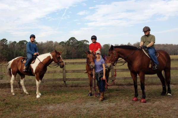Military riders on horseback.