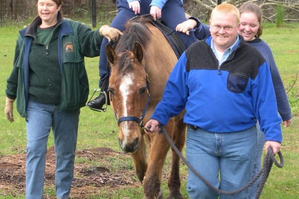 Participant enjoying a therapeutic riding session.