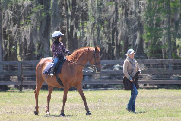 Lilia and Reba riding together.