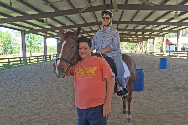 Retired news anchor, Don Germaise leads horses for therapeutic riding sessions every week.